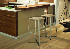 You can get right into the swing of things at breakfast with the lux bar stool! Its innovative design brings motion to seating. | TEAM 7