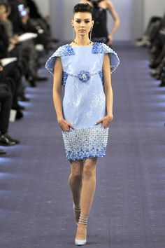 http://www.vogue.co.uk/fashion/spring-summer-2012/couture/chanel/full-length-photos/gallery/720735