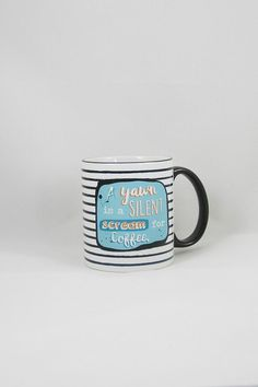 For those who are morning-challenged! Design is heat pressed into the mug so they are won't ever fade. They are also scratch proof and dishwasher safe.  Measures 11 oz.  Scream Coffee Mug by Fly Paper Products. Home & Gifts - Home Decor - Dining - Dinnerware Rhode Island