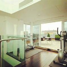 Modern design throughout this #StJohnsWood, #London penthouse apartment, opening out onto the terrace. Work out indoors, with a great view.    #RealEstate #London