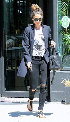 Nikki Reed emphasizes street style cool in black ripped jeans, a vintage tee, and a chic blazer. // #StreetStyle