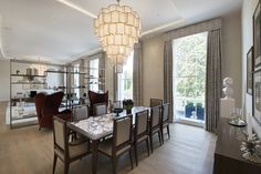 1508 London Park Crescent - luxury interior design, open plan dining room and seating area with chandelier.