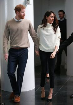 Harry showed off his pride as a fiancé, walking slightly ahead of her as they held hands ...