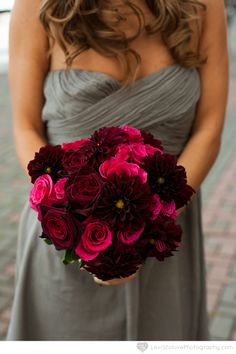 Raspberry black and magenta bridesmaid bouquet of gray dress by Limelight Floral Design Hoboken NJ