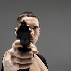 Eminem.....shirtless....with guns....that's hot.
