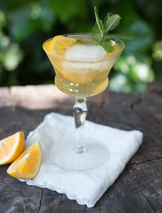 Mix equal parts lemonade (for a bit of sweetness) and seltzer, plus a shot of bourbon, over ice. Garnish with a lemon slice and a sprig of mint!
