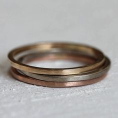 Solid gold stacking rings made from 14k gold. This is a set of 3 solid 14k gold stacking rings that you can mix and match the color gold. These solid gold stacking rings are small and elegant and made from yellow gold, white gold and rose gold. The rings comes as a set of 3 and are solid 14k yellow gold, 14k white gold and 14k rose gold ring (one of each). Use the pull down menu to select the combination of gold (i.e. 2 white, 1 yellow) you would like. This listing is for THREE rings. The…