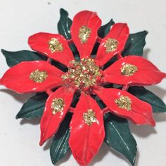 b84c75b30ea Mid Century painted enamel floral Christmas holiday brooch Poinsettia  flower has red petals with green leaves