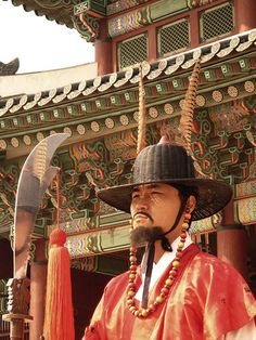 Korean Palace Guard: A guard at Seoul's Gyungbok Palace (경복궁.景福宮) stands menacingly guarding the main gate with his face reflecting in his shined metal knife.