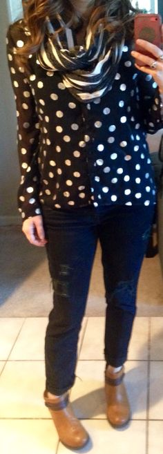 Beige and grey striped scarf, black and silver polka dot blouse, distressed black jeans, tan ankle boots.