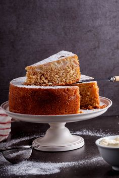 Rich, buttery spiced pear butter cake with sweetened whipped cream is the ultimate afternoon treat.