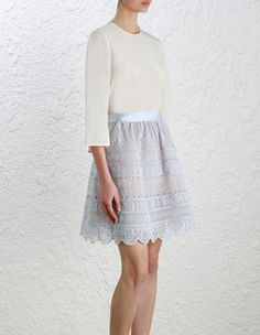 Zimmermann Adorn Embroidered Bell Mini. Model Image.  Our model is 5 10 and is wearing a size 0