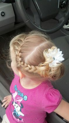 My daughters french braided toddler hair. Other side is also in a french braid:)