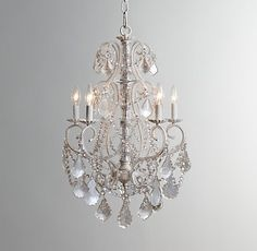 Aislynn Mercury Glass Chandelier in white by Restoration Hardware makes quite a statement! We love the combination of crystal, glass beads and mercury glass for a vintage look. $500 plus shipping.