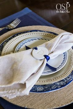 Thanksgiving Tablescape with handmade clay tag napkin holder, vintage plates, burlap chargers and linen napkins. DIY and budget friendly! | onsuttonplace.com