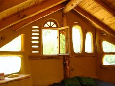 Natural Finishes - Firespeaking - COB HOUSE - Love the fact that there is no symmetry to these windows, just random light :] - Cob Building, Green Building, Organic Architecture, Residential Architecture, Contemporary Architecture, Eco Construction, Mud Hut, Earthship Home, Tadelakt