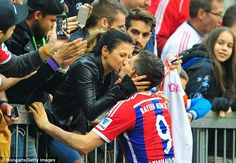 Lewandowski kisses his wife Anna Stachurska after his side completed a routine victory...