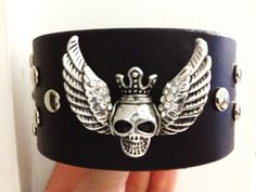 Black studded leather bracelet cuff, silver skull & rhinestone wings, skull bracelet, black leather bracelet. on Etsy, $20.00