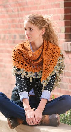 This crochet shawl is definitely eye catching. I love the edging!