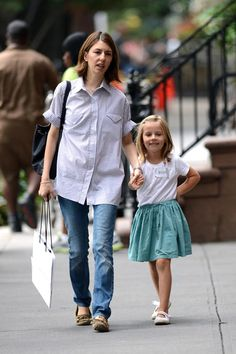 Sofia Coppola moccasins and oversized striped short sleeve button down with jeans