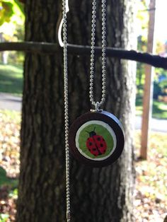 mod green and red ladybug wine cork necklace by quarkcorks on Etsy