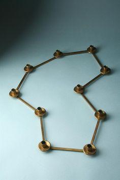 Anonymous; Adjustable Brass Candle Holder by Svenskt Tenn, 1950s.