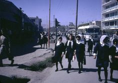 Afghanistan in the 1960's: Afghan girls coming home from school. Both Afghan boys and girls were educated until the high school level.