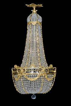An Antique Gilt Bronze And Cut Crystal Tent Bag Chandelier With Enamel Band