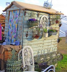 gypsy caravan  I like the idea of a garden shed, with herbs planted around it.