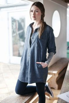 100% Cotton    A classic shirt dress, in pretty cotton chambray. Casual fit, with button up front, single button pocket and roll up button sleeves. The perfect base for colourful accessories.  £49.95