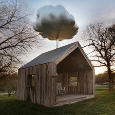 A cloud hanging over this shed-like pavilion in Missouri by artist Matthew Mazzotta rains onto the roof whenever someone sits inside.