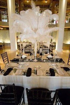 large tables with ostrich feather centerpieces