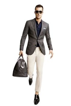 Shop this look on Lookastic:  https://lookastic.com/men/looks/blazer-polo-chinos-loafers-duffle-bag-sunglasses/12896  — Dark Brown Sunglasses  — Navy Polo  — Dark Brown Blazer  — Beige Chinos  — Black Leather Duffle Bag  — Black Leather Loafers