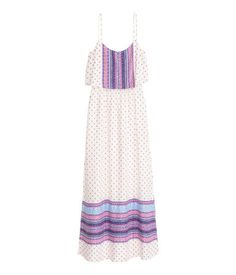 Check this out! Maxi dress in a patterned viscose weave with a wide flounce at the top, narrow adjustable shoulder straps, an opening with a button at the back of the neck, an elasticated seam at the waist and slits in the sides. - Visit hm.com to see more.