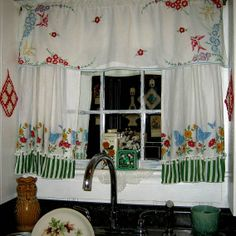 I always hated this window so I put a mirror that looks like a window and just fits over it. Made curtains out of feedsack and a valance out of a dresser scarf.
