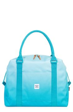 Pack vacation essentials in this bright blue duffel bag from Herschel.
