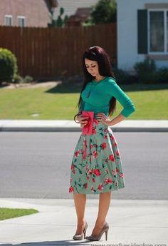 Emerald cardi, green floral print skirt, nude heels