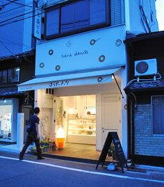 japanese doughnuts {in kyoto}. - Oh Joy! Cafe Restaurant, Restaurant Design, Cafe Signage, Vintage Bakery, Japanese Lifestyle, Mall Stores, Cute Donuts, Bottle Shop, Bistro