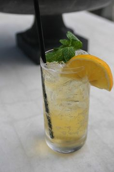 Wheat beer, gin, and mint are the shining stars in this beer cocktail.