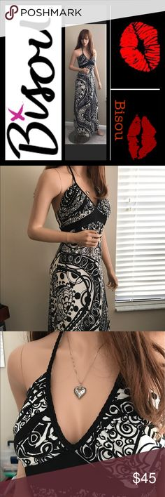 """Black & White Paisley Maxi This can be worn very casually or dress it up with wedges. You will love this dress. ◼️Paisley Black & White Maxi Dress. Stunning!! Never worn.Has braided detail on breast area. Wear with sandals or heels, a definite eye turner!! Made in the Philippines. 92% polyester, 6% spandex, lining 100% cotton. Size 6 🎉HOST PICK🎉3/30 """"Insta Chic Party🎉 5/9 """"Night Out Party"""" 🎉 Bisou Bisou Dresses Maxi"""