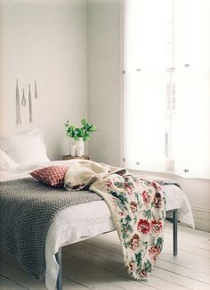 A colorful throw keeps the simplicity more than a colorful duvet does, and ties more colors into the room.