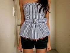 Navy and white striped sleeveless shirt with bow
