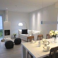 Olohuone ja ruokailutila on jaettu valolla. Kuva ja valaistussuunnittelu Tampereen Valo ja Sisustus.