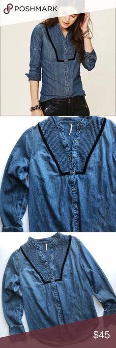 "Free People Chambray Button Down Soft Chambray button down with black velvet trim and neckline pleating • arms have white spotting (intentional design of top) • 100% cotton • 18.5"" bust • 26"" length • excellent condition ❤️ Free People Tops Button Down Shirts"