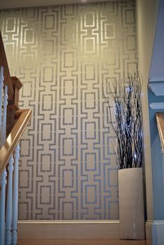 wall stencils + metallic paint.  Would be really cool for the 1/2 bathroom.
