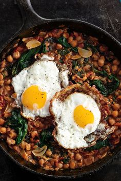 A garlicky, greens-filled chickpea stew gets even better thanks to crispy fried eggs.