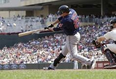 Cleveland Indians' Jason Giambi hits a three-run, game-tying home run off Minnesota Twins pitcher Casey Fien in the eighth inning of a baseball game, Wednesday, Aug. 14, 2013 in Minneapolis.