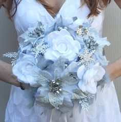 DRAMATIC Winter Wonderland Feathers & Flowers Bridal Bouquet White Silver Snowflake BLING WEDDING Feather Poinsettia Rose Bride Bouquets. $95.00, via Etsy.