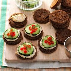 """Cucumber Canapes Recipe -""""I always get requests for the recipe whenever I serve these delicate finger sandwiches with a creamy herb spread and festive red and green garnishes,"""" reports Nadine Whittaker of South Plymouth, Massachusetts. Cold Finger Foods, Party Finger Foods, Finger Food Appetizers, Holiday Appetizers, Tea Party Sandwiches, Finger Sandwiches, Canapes Recipes, Appetizer Recipes, Plymouth Massachusetts"""