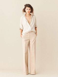 An Undone Suit  Style a relaxed trouser in a lightweight, dressy fabric with an easy camisole. Wear the look with a little feminine heel and a dressy clutch.
